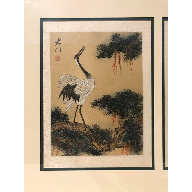 Two watercolor cranes on silk, signed and stamped. Made in the early 20th century.