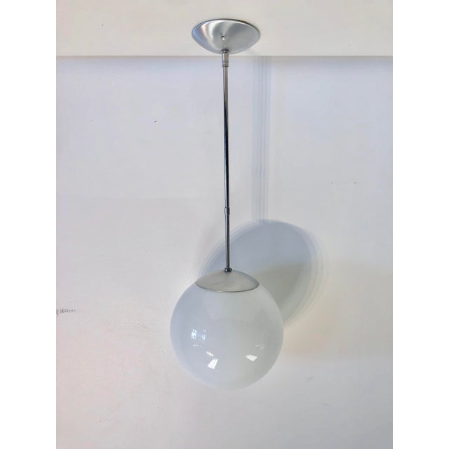 Mid-century chrome pendant with oversized globe to be mounted and hardwired.