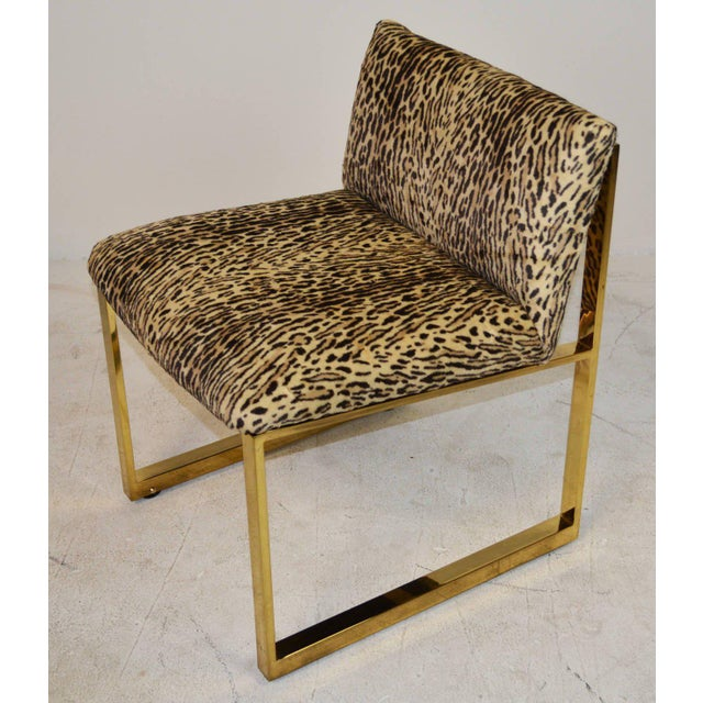 A pair of small-scale slipper chairs by Milo Baughman for Thayer Coggin. Brass frames with hidden rollers. Original tag...
