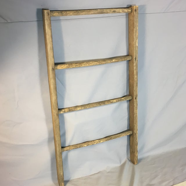 Vintage rustic country ladder with four rungs. Great for flowers or to decorate your home!