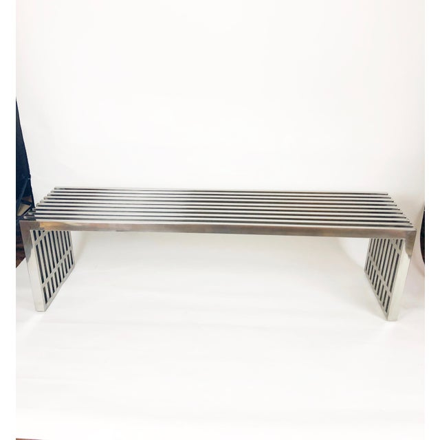 This Milo Baughman chrome bench is perfect in an entry or as a seating divider. The bench has several small scratches on...