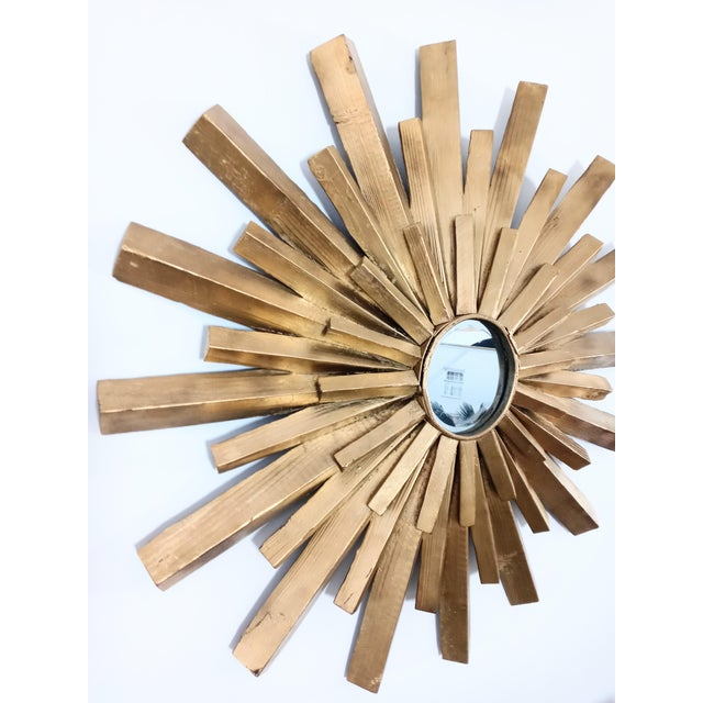 Beautiful large solid carved wood starburst wall mirror. The wood has been painted a nice bright gold color. The frame is...