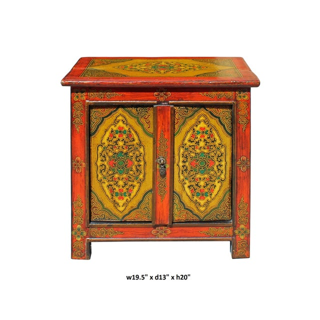 This cabinet / table is painted with colorful Tibetan style graphic at the front and the top . It is a special color...