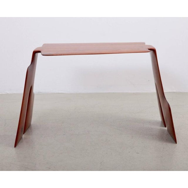 One of a kind Robert Schultz side table in solid walnut in excellent condition. Schultz studied at the University of...