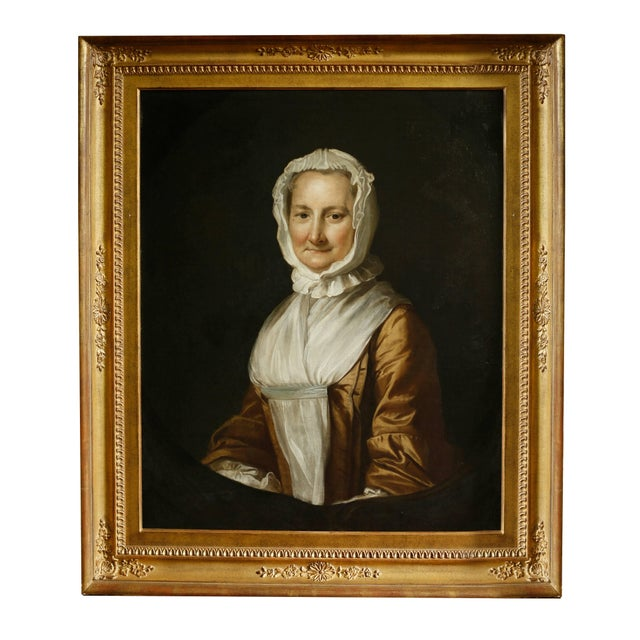 An attractive pair of colonial American mid-18th century oil on canvas portraits. The detail and rendering of the...