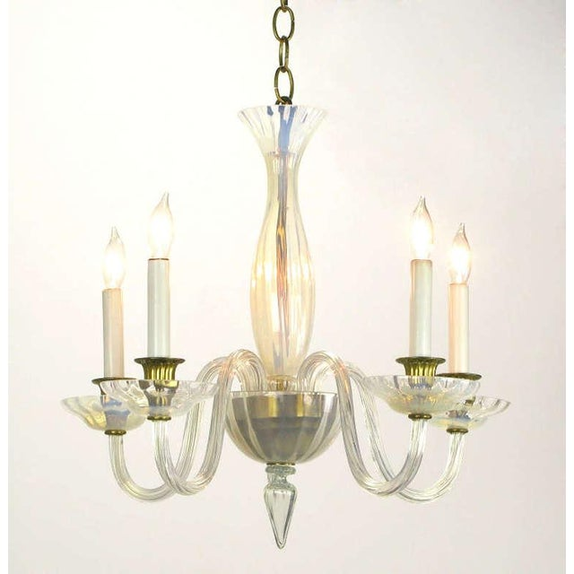 Opaline Murano glass empire style chandelier with brass candle cups and brass center bowl inside an opaline glass bowl....