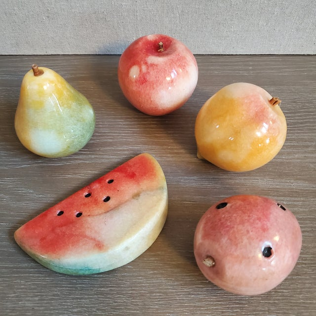A 5 piece set of Vintage Italian marble fruit (peach, apple, pear, dragonfruit, watermelon). The fruit has been turned and...
