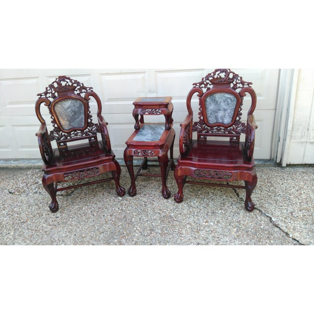 For sale is a Pair of Chinese carved solid rosewood marble back armchairs set. Two Chinese carved solid rosewood marble...