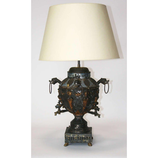 An amazing tole samovar mounted as a lamp. Wonderful patina with remnants of paint and gold leaf visible. The piece is a...