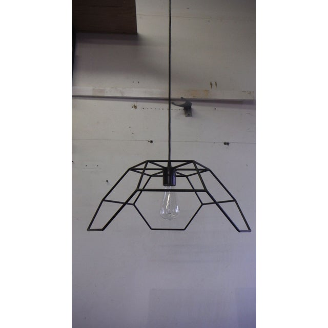 This truncated hexa-pyramid ceiling pendant light with welded bronze joints is unique and fabulous. Traditional bronze and...