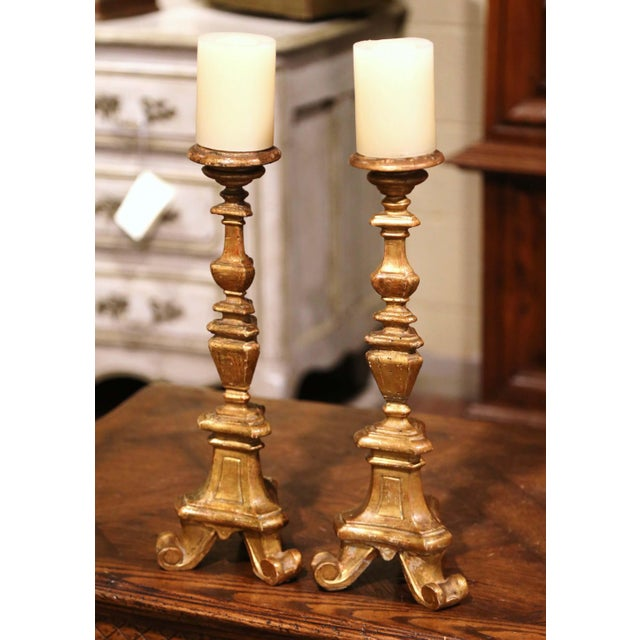 Created in Italy circa 1880, each two-tone candle holder stands on a three-leg base triangle base over a decorative carved...