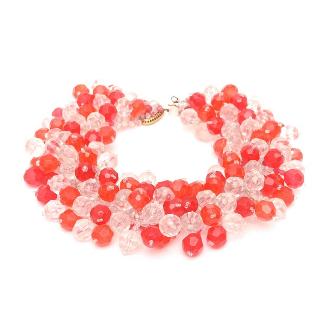 This amazing and arresting Italian vintage cluster of pop hued plastic beads in orange/red and interspersed with crystal...