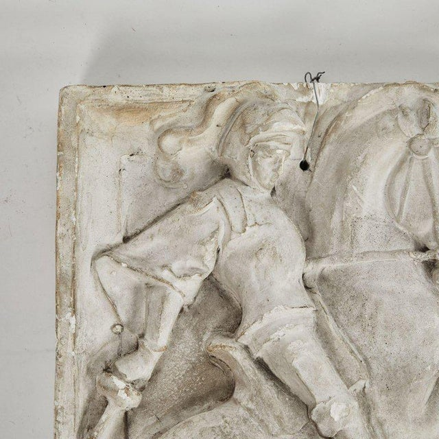 A carved architectural relief in plaster, originating in England, circa 1890.