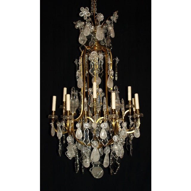 "Louis XV gilt bronze and crystal ""cage style"" chandelier featuring rock crystal pendalogues"