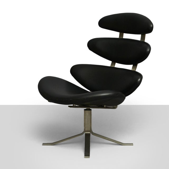 A model EJ-5 Corona lounge chair designed by Poul M Volther inspired by photos of a solar eclipse. Features leather...