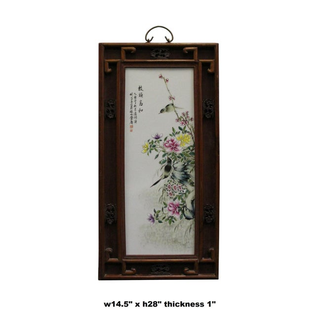 This is a vintage traditional Chinese oriental wall decoration piece made of wood frame and porcelain center plaque with...