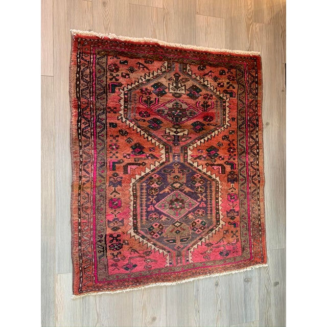 Beautiful rich reds, orange and pinks bring this little rug to life. Perfect in an entry way or under your feet in the...