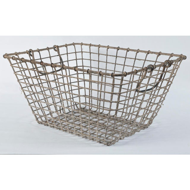 Vintage French oyster baskets, Set of two, 20th Century. Used by French oyster farmers at low tide for harvest. Aged patina.