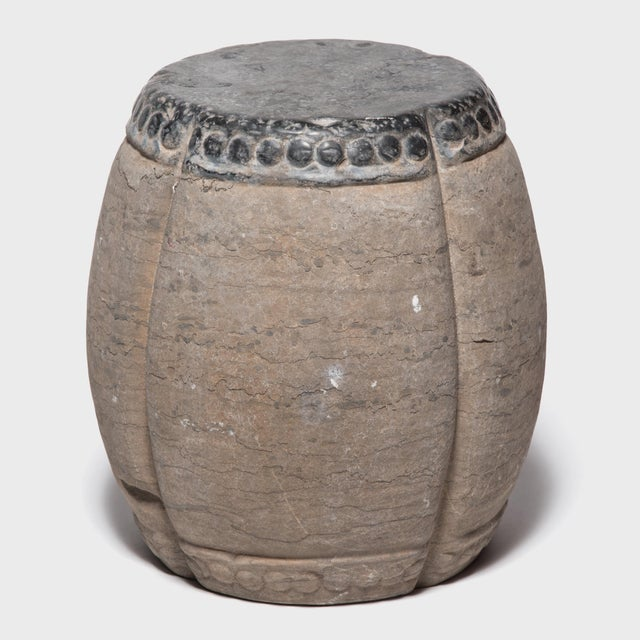 Marked by expressive veining, this handsome stool was carved in China's Shanxi province out of a piece of solid limestone....