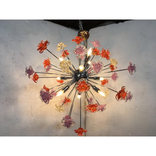 This is a contemporary Murano glass Sputnik flower chandelier. Metal frame kromo. Flowers: Murano glass red and violet and...