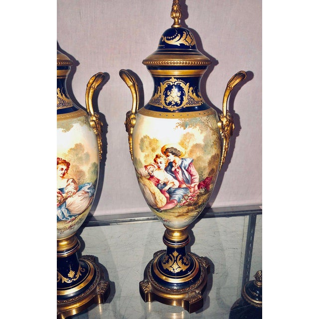 Pair Of Sevres Vases Signed With Bronze Mounts And Masked Handled