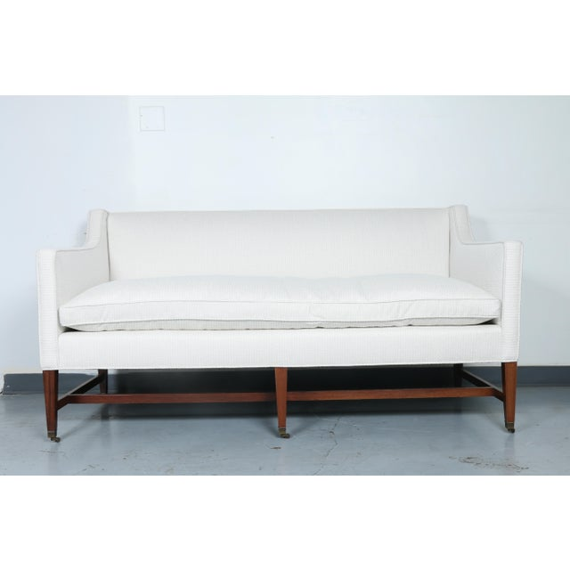 Just reupholstered white mid century modern love seat in excellent condition. No damages or stains. Wheels roll perfectly.