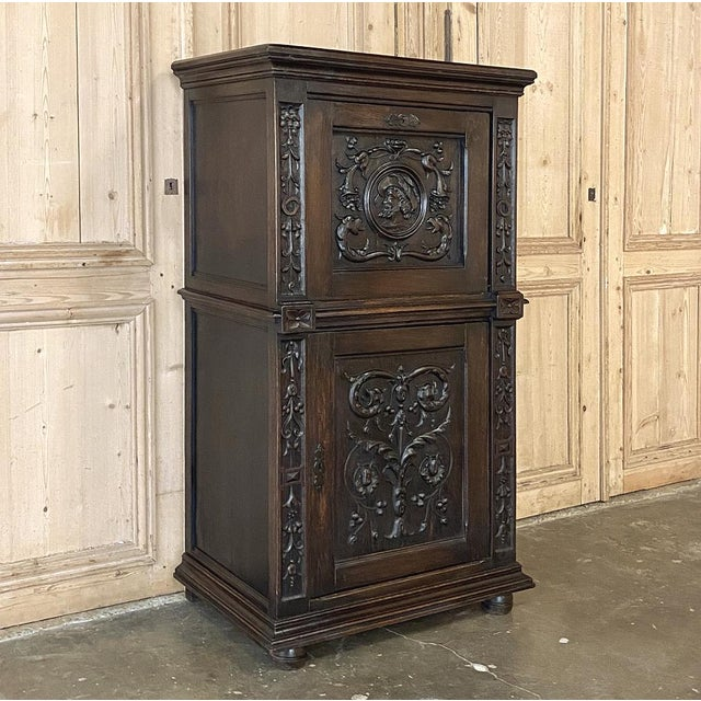 This handsome French Renaissance Oak Cabinet features a nobleman and wonderfully executed bas relief carvings of foliates...