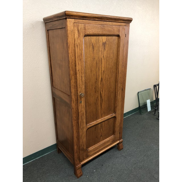 Design Plus Gallery presents a petite oak armoire. Retrofitted to house small screen and components, this piece would work...