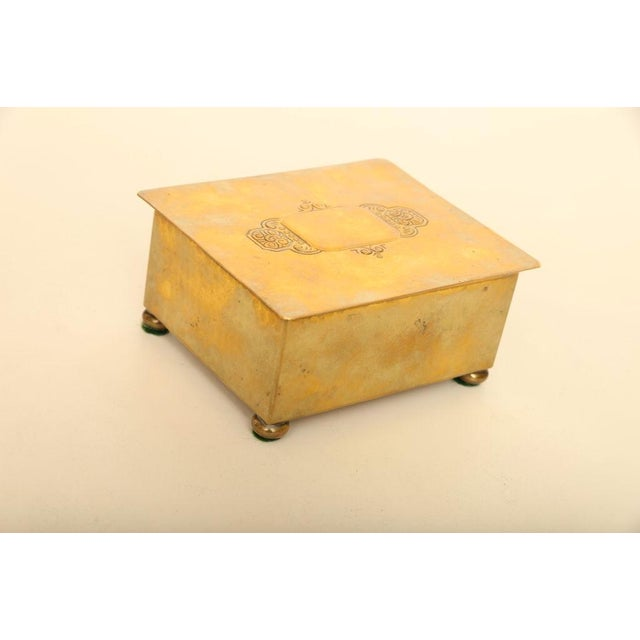 This small art deco WMF box is constructed of hand hammered brass over wood. The box has four small bun feet and is...