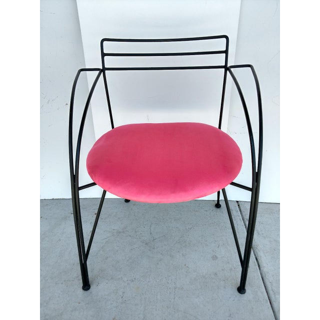 This is a French Twist Chair, deigned by Pascal Mourgue. It won the 1985 contest for the Foundation Cartier Cafe. It is...