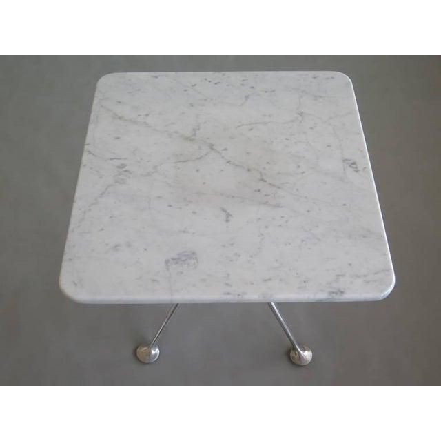 A rare marble top table by Alexander Girard for Herman Miller, circa 1960s.