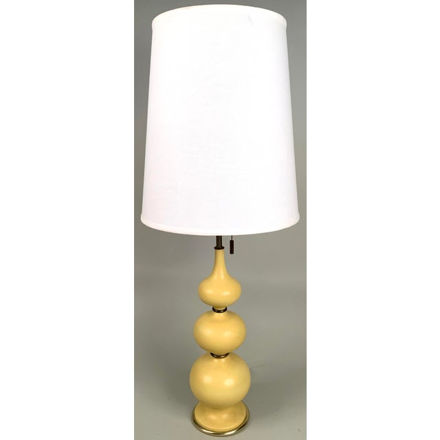A beautiful pair of vintage 1960s table lamps designed by Gerald Thurston for Lightolier. the bases with a series of...