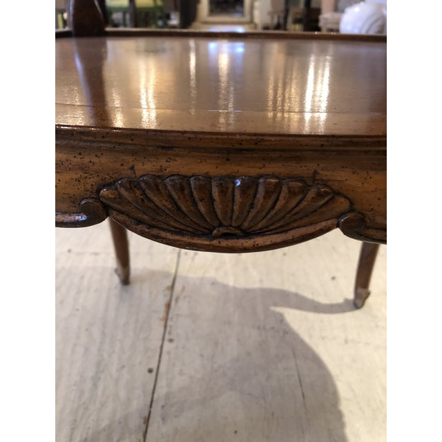 French Provincial style marble inset two-tiered oval side table having handsome carved wood with cabriole legs and...