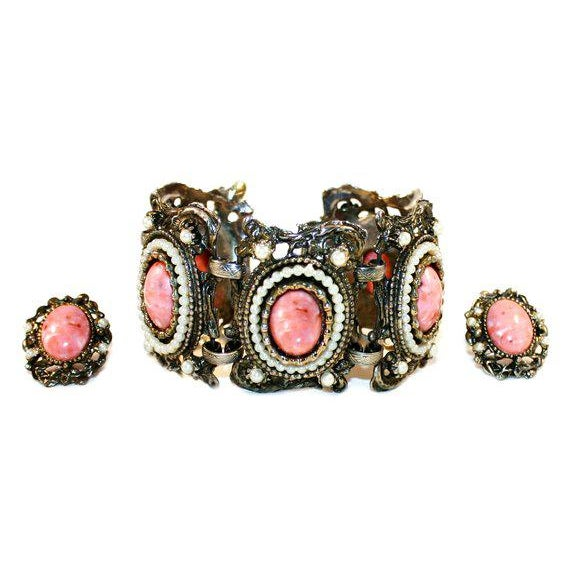 Great 1950's mid century ornate goldtone metal bracelet and clip back earrings set with faux-coral cabochons surrounded...