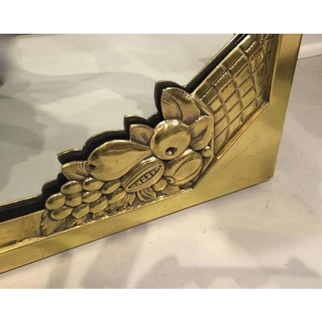 Beautiful French Art Deco brass wall mirror with fruit decorations. Stunning Deco details. Re-plating upon request.