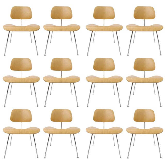 A set of 120 Eames DCM chairs in white ash. These superbly designed chairs have remained in production since 1949 with...