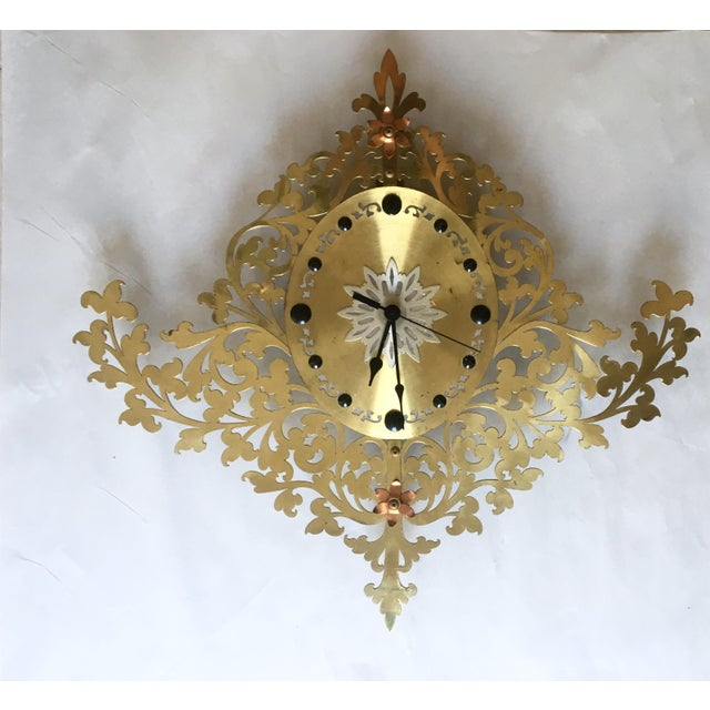 Stunning, large vintage wall clock. Gorgeous Filigree, three toned metal front, with silver, gold and copper colored...