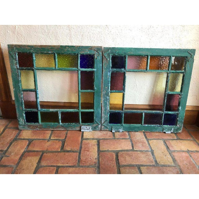 Pair of stained glass windows. Bright and colorful these would add to any interior or exterior project. The colors include...