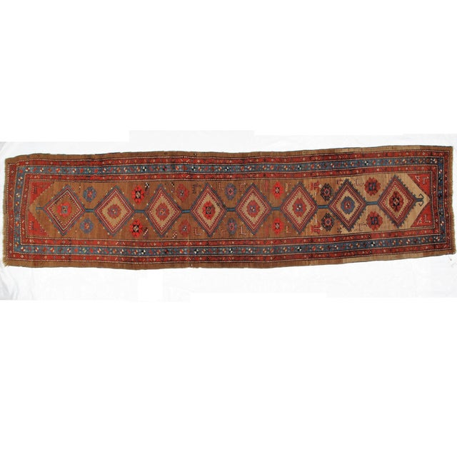 This master piece is a wool on wool pile genuine hand made antique North West Persian Bakhshaish runner in excellent...
