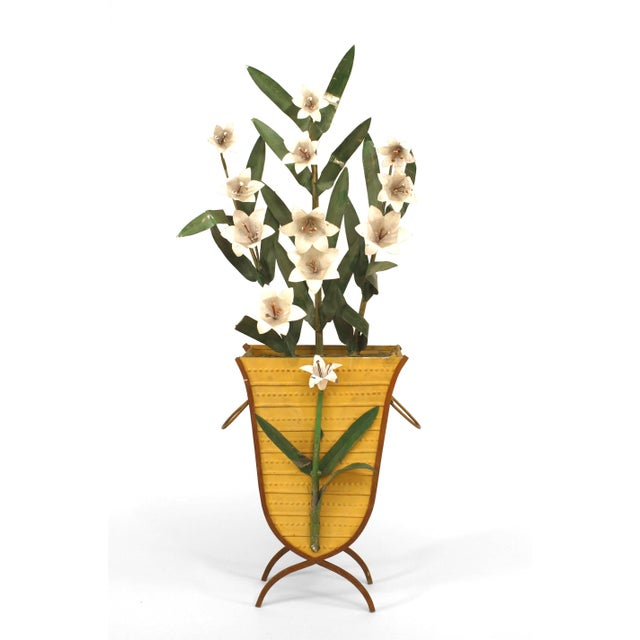 Pair of American Art Moderne, 1940s-1950s painted tole basket with handles holding a spray of white lillies.