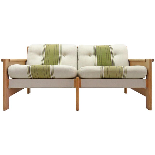 Bold and comfortable Danish modern two-seat sofa by Bernt Petersen, Denmark, 1970, oversized oak frame with dual colored...