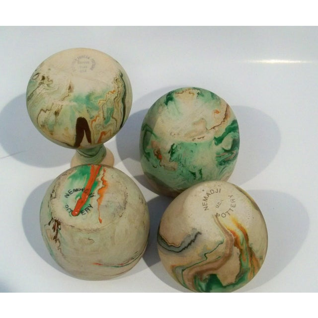 Collection of 4 pieces of vintage Nemadji vintage, roadside, pottery. Swirled colors of green and orange surround each...