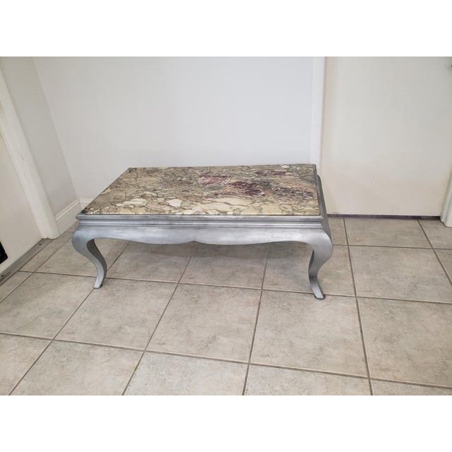 My mother ordered this marble from Italy in 1970 to match her rug. She had it put into a Queen Anne style cherry-wood,...