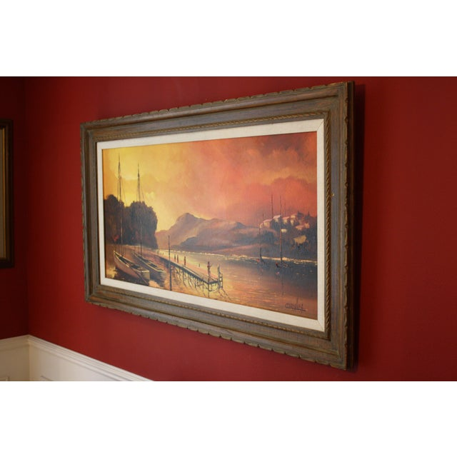 Here is a striking original signed mid century oil on canvas by Cuban artist Julio Carballosa. It is a beautiful harbor...