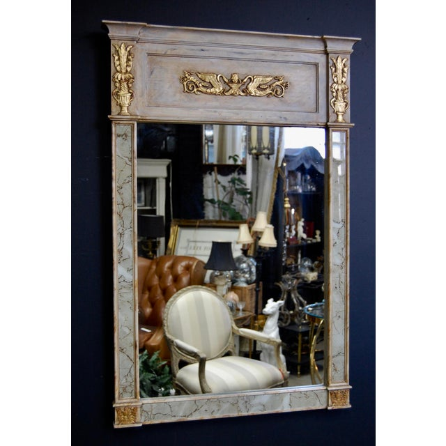 Classically French and timeless styling, meet your next heirloom piece. Spectacular aged creamy ivory trumeau mirror with...