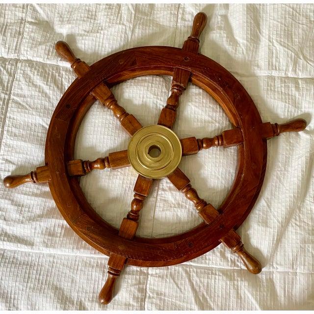 Handsome 1960s vintage wood & brass boat steering wheel. Fun, authentic coastal decor.