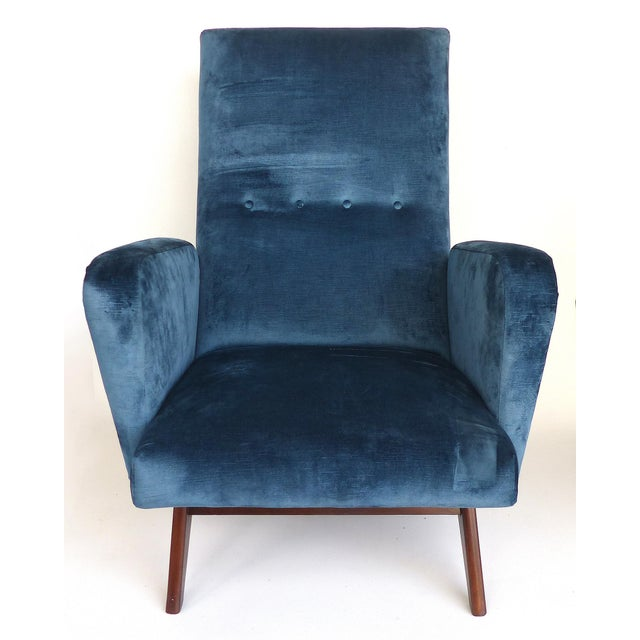 Offered for sale is a pair of petite Italian Mid-century Modern blue velvet club chairs. These chairs are very comfortable...
