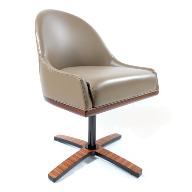 Offered for sale is a pair of swivel chairs designed by Umberto Asnago and handmade by the luxury Italian manufacturer...
