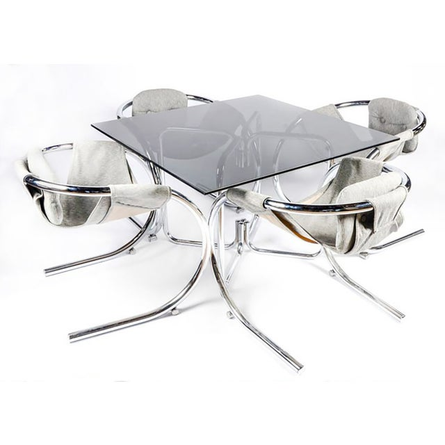 A rare, sculptural Byron Botker for Landes chrome dining set. A truly rare and stunning dining set by Byron Botker for...