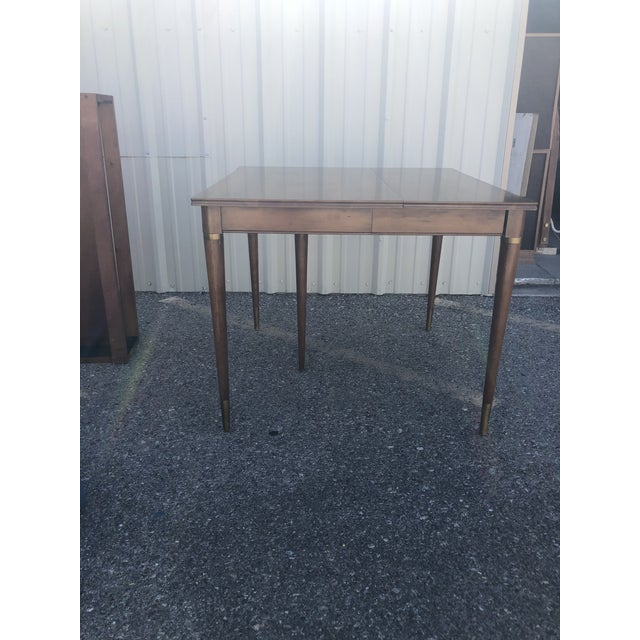 Brown Saltman dining table. Includes 3 leaf's are included with leaf caddy. Original finish. See listing with Brown...